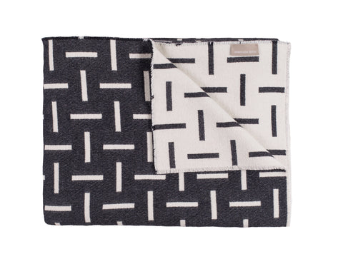 Monochrome, merino wool blanket. Contemporary, geometric design. Woven in England.