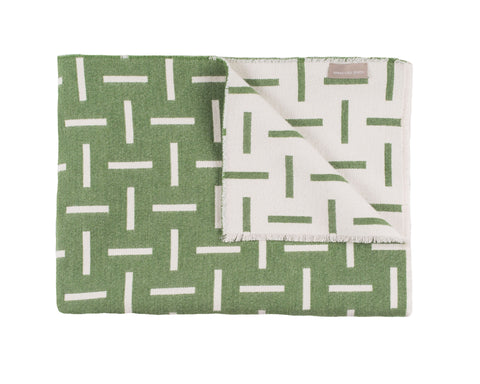 Green merino wool blanket. Contemporary, geometric design. Woven in England.