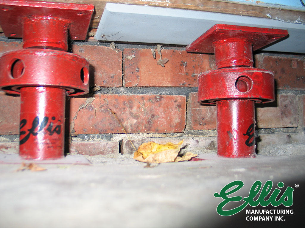 Close Up Of Lifting Jacks under wall Footer - Ellis Manufacturing Co.
