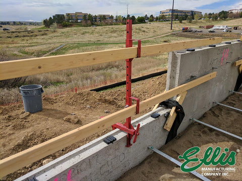 One Ellis Manufacturing Co Parapet Guardrails on top of retaining wall