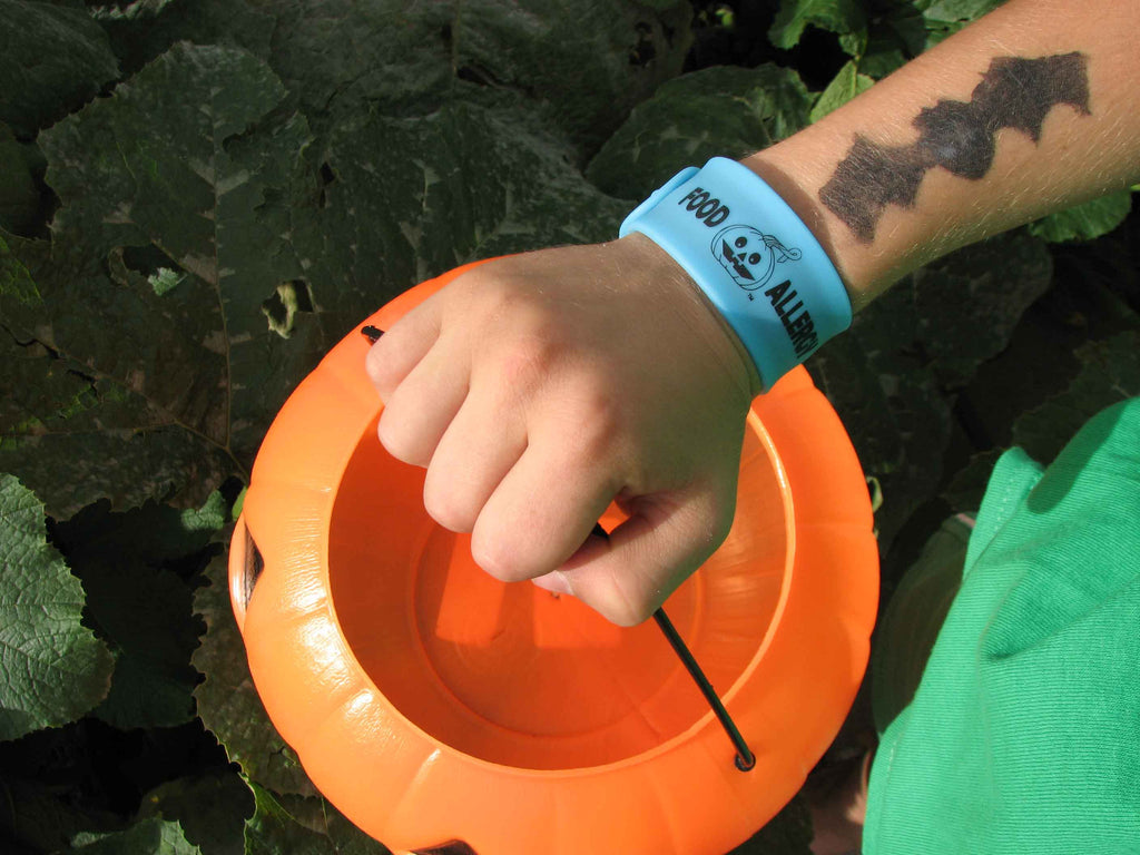 Teal Pumpkin Glow-in-the-Dark Food Allergy Slap Bracelet by Allergy Superheroes.