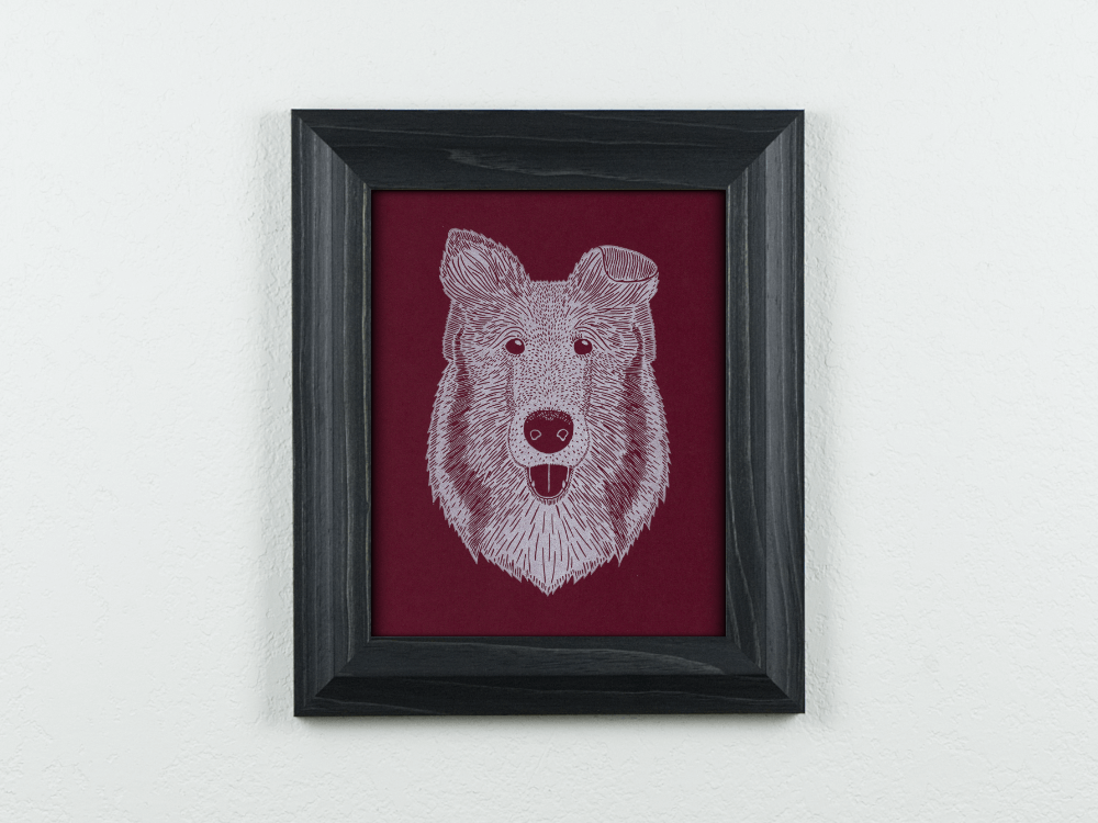Collie on maroon paper