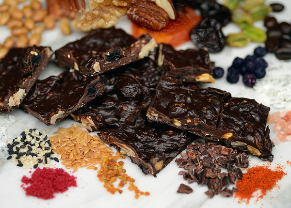 Brooklyn Bark - HANDCRAFTED MELTING POT of dark chocolate with assorted nuts and fruits, flax, sunflower, chia seeds coconut, spices and grey sea salt. Ingredients