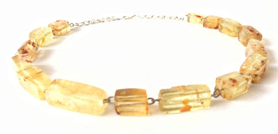 Silver necklace with natural amber stones.