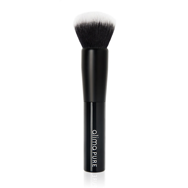 POWDER BRUSH <br> Domed Taklon bristles blend and buff face powders to a smooth, even finish