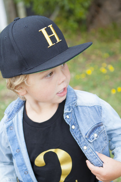 George Henry Youth Black Monogrammed Snapback Cap Gold Letter ... 8589794cb9d2