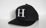 George Henry Youth Black Monogrammed Snapback Cap With White Letter