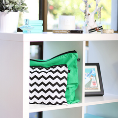 Chevron and green handbags dust covers on shelf