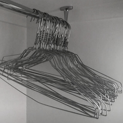 Wire hangers on wardrobe rail