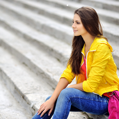 Model wearing yellow jacket with jeans