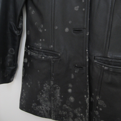Black leather jacket with mould spots