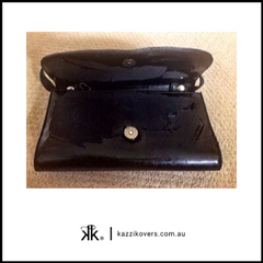Black patent handbag which has peeled
