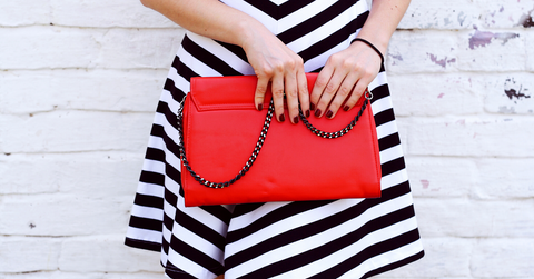 Red handbag with model in chevron dress