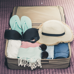 Rolled and folded clothing in suitcase