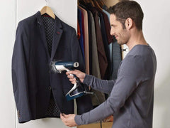 Suit steamer to iron out wrinkles and remove odours from garments