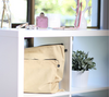 Large and medium beige cotton bags displayed on shelves