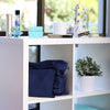 Midnight Blue handbag dust bags displayed on shelf