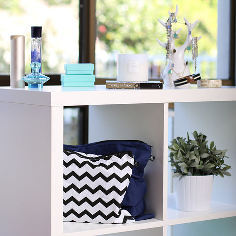 Midnight Blue and Chevron print handbag dust bags displayed on shelf