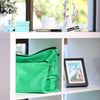 Green cotton bags for handbag care on shelves