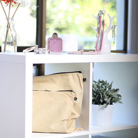 Organised handbags on shelf in beige covers