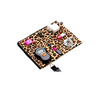 Electronics and cords in leopard print travel packing cell