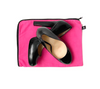 Black heels and pink dust bag for shoes storage and travel