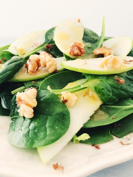 Spinach salad with handcrafted jam salad dressing.
