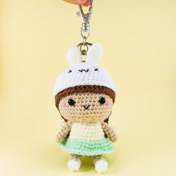 Girl Doll Wearing Bunny Hat with Keychain attached