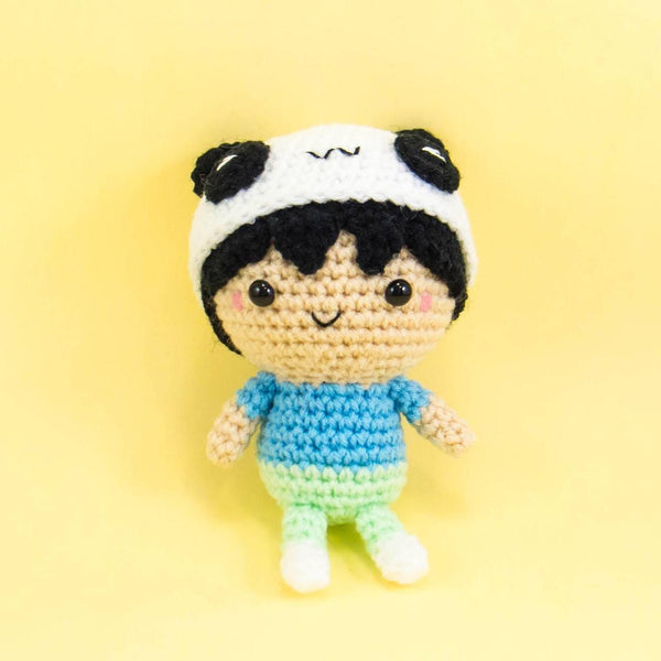 Crochet doll wearing panda hat
