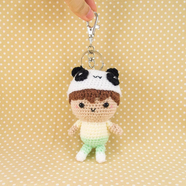 Boy wearing Panda Hat Doll with Key Chain Attached