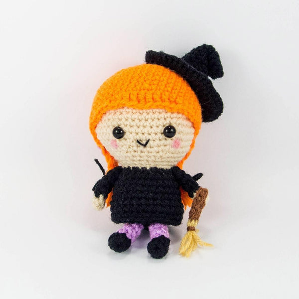 Witch crochet toy with orange hair