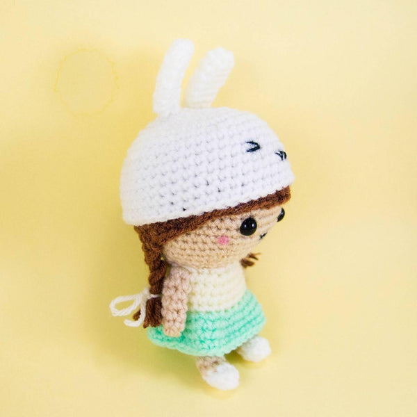 Cute Doll wearing Bunny Hat Side View