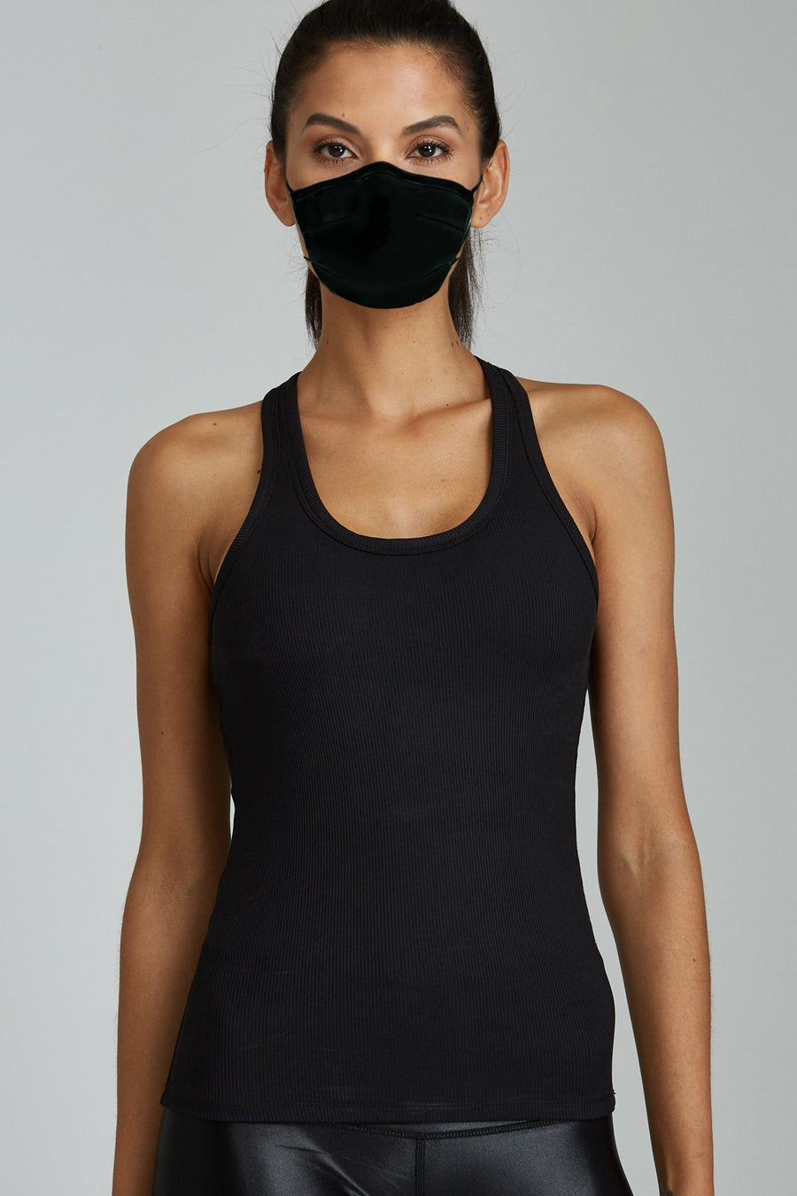Woman wearing Black Face Mask and Black Tank Top