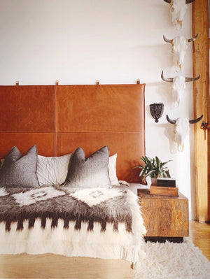 modern bedroom update hanging headboard caramel brown leather bed