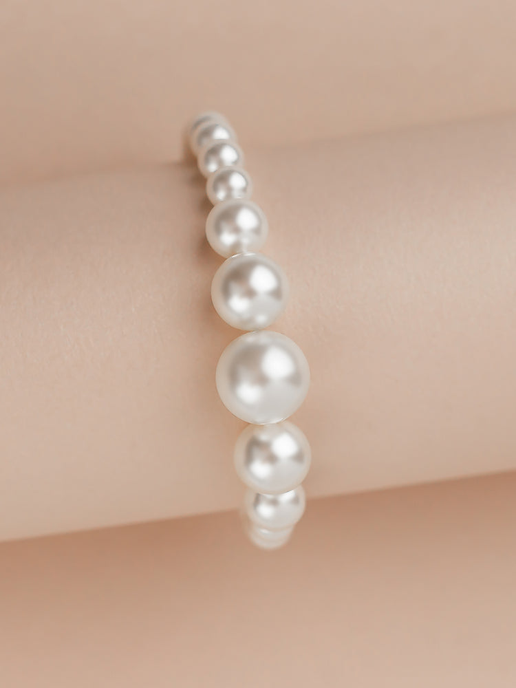 Load image into Gallery viewer, Graduated Pearl Gold Bracelet