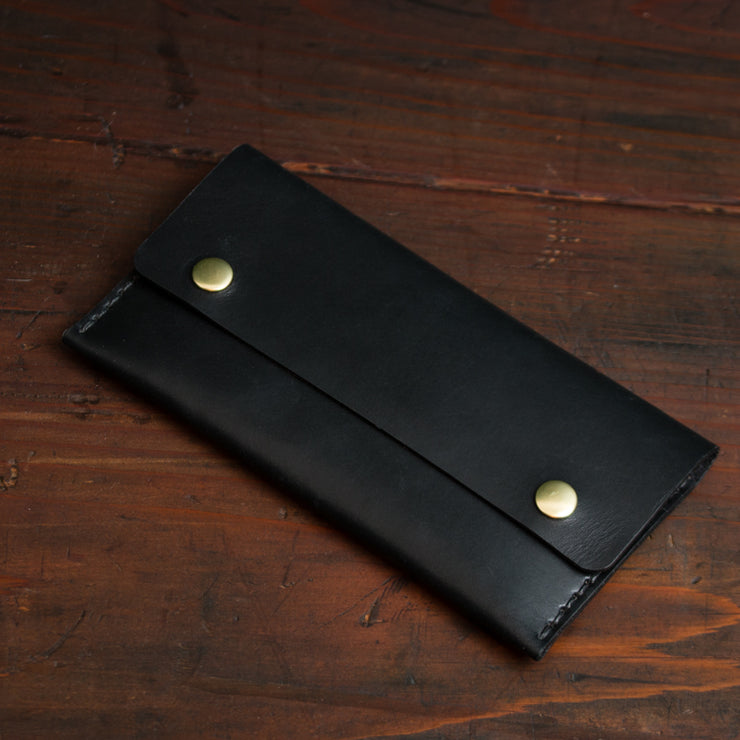 Long black women's wallet with brass snap buttons