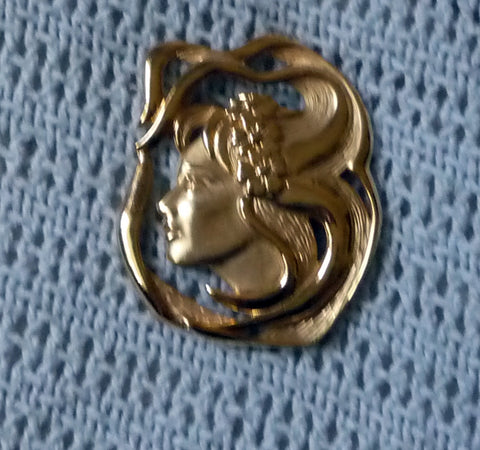 Art nouveau style gold tone brooch of beautiful woman with flowing hair