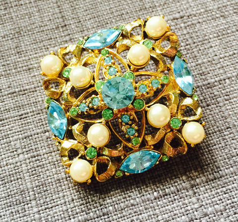Blue rhinestones and faux pearls in a brooch - Stop Making Senz a Maker Studio