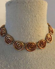 Copper-colored coil necklace with classical appeal