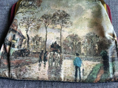 Leather change purse with detailed landscape