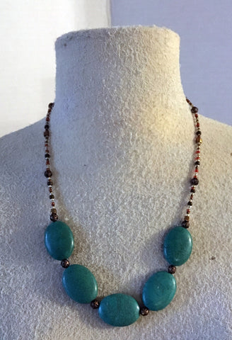 Necklace of large turquoise color stones and small copper like beads