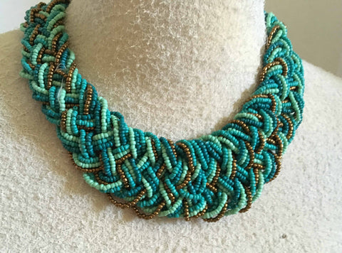 Striking turquoise and copper braided bead necklace