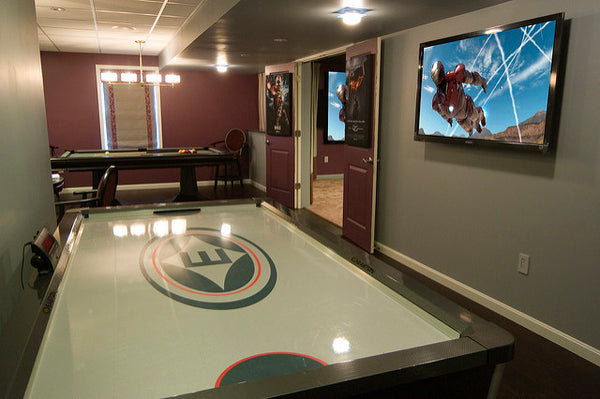 a well-maintained air hockey table set up in a living room