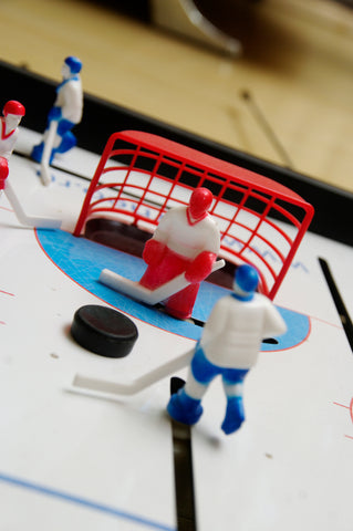 Close-up of dome hockey players on a Carrom dome hockey table.