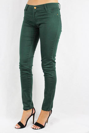 hunter green skinny jeans with pocket stitching