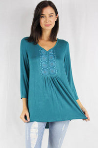 women's long sleeve embroidered blouse with relaxed pleats