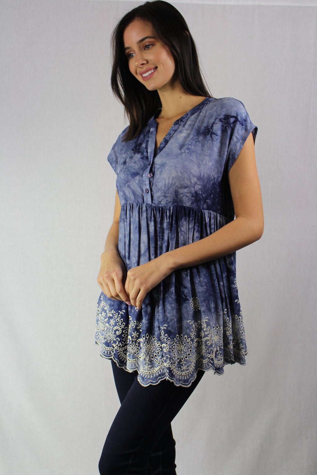 sleeveless denim blue top with embroidered details