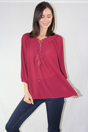 long sleeve chiffon top with a lace up neckline