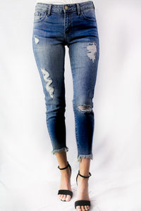 dark wash mid rise destroyed crop skinny