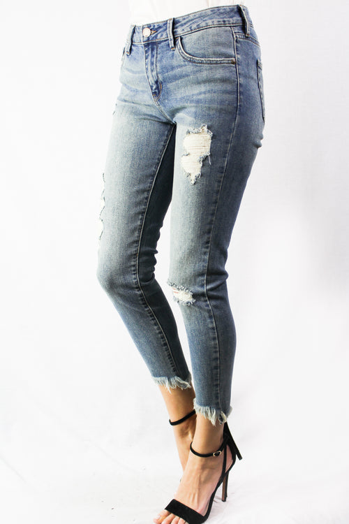 medium wash mid rise destroyed crop skinny
